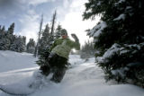 (DLM4447) -   Jake Williams, 29, of Denver floats through the powder as he rides through a glade...