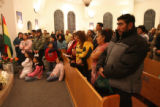 Hispanic community members of Greeley, Colo., attend Mass on Tuesday night Dec. 12, 2006 to show...