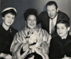 Broadway star Ethel Merman holds Easter rabbit given to her children, Ethel, 13, abd Robert, 10,...