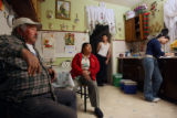 MJM207   Salvador Figueroa, left, sits in the kitchen of his family's Denver home Wednesday...