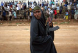 (NYT57) MOGADISHU, Somalia -- Dec. 8, 2006 -- SOMALIA-ETHIOPIA-1 -- A woman carryies an assault...
