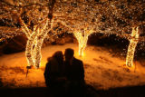 (DLM2001) -  Jennifer Menard, left, and Brad Hildebrand, both of Littleton, share a kiss under the...