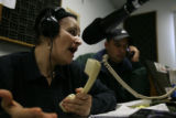 (DLM5603) -   Elda Gamez, left, and her brother Simon Gamez field calls from people with questions...