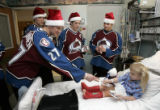Makayla Heids (cq), 6, from Keenesberg, CO, gets an autograph from Colorado Avalanche hockey...