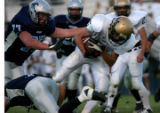 Arvada, Colo. 9/2/04- Monarch's #5-Nick Weber tries to make it past Ralston Valley's #77-Randy...