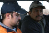 (DLM5992) -   Miguel Vasquez, left, and Humberto Fuentes, both workers at the Swift & Co....