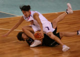 XKC116 - Sun Chieh-ping of South Korea sits on Yuko Oga of Japan during the Asian Games Basketball...