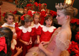 (Denver, Colo., December 1, 2006) Sugarplum Fairy Kristin Irby, right, talks with some of the...
