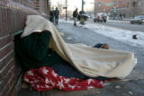 Carlos Ramos, cq, of Puerto Rico, cover himself with a blanket Thursday Nov. 30, 2006, to keep the...