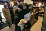 Brandy Shelley (cq) hugs waitress Nikki Rivera (cq) goodbye as she holds the multiple plates of...