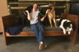 Wheatridge, Colo., Aug. 16, 2004- Kelly Beasley, owner of a Camp Bow Wow Doggie Day Care of...