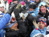 Family members of Bode Miller catch a bouquet of flowers thrown to them by Bodie Miller during the...