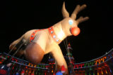 (DLM2086) -   The Rudolph the Red Nosed Reindeer Balloon passes in front of the Denver City and...