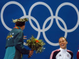 (ATHENS, GREECE-AUGUST 19, 2004)  United State's gold medal winner, Amanda Meard, right, jokes...