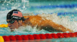 (ATHENS, GREECE-AUGUST 19, 2004)  United States' Michael Phelps swims the butterfly in the Men's...