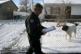Animal Welfare Investigator, Keith Davis, cq, with the Dumb Friends League,  does a welfare check...