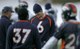BG0058 The Denver Broncos new  starting quarterback Jay Cutler, third from left, talks with...