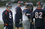 BG0177 The Denver Broncos new starting quarterback Jay Cutler, left, looks toward the media during...