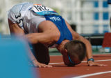 (Athens, Greece  on Friday, Aug. 20, 2004) - Ivano Brugnettii of Italy kisses the track upon...