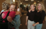 (BOULDER, CO., MAY 17, 2004) Melissa Vaughn, left, gives Janice Branam, facing, a hug as Branam's...