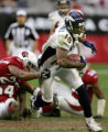 Brandon Marshall tries to shake a tackle by David Macklin in the 4th quarter of the Denver Broncos...