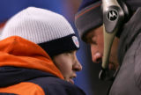 Jay Cutler talks with one of the coaches in the first quarter of the Denver Broncos against the...
