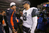 Jay Cutler talks with Matt Hasselbeck after the Denver Broncos against the Seattle Seahawks at...