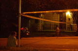 (DENVER, Colo. August 19, 2004) A young boy waits for his bicycle at the edge of the crime scene...