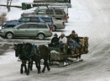 Walt Turner (cq) drives a sleigh with visitors up Redstone Ave Thursday December 14, 2006 in...