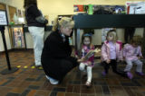 (DLM7522) -   Mindy Hartley, left, reads to her daughter, Georgia Hartley, 3, as Vivian Kenney, 2,...