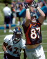 (DENVER, COLO., MAY 7, 2004)   Denver Broncos' #87, Jed Weaver, right, pulls down a catch in front...