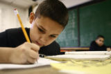 Dupont Elementary School fourth grader Saige Lafferty, cq, 9, works on a spelling exercise during...