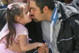 April 4th, 2007. (from left) 3 year-old Noelia Puga kisses her father  Gustavo Puga (cq) as...