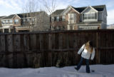 Grace Harris, 6, kicks the snow in the backyard of her family's southwest Denver home before she...