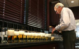Steve Presley (cq), Senior Assistant Brewmaster, Fort Collins Anheuser Bush, Inc., pours beer to...