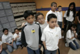 Fifth-graders Hector Dominguez, 10, left, Isaac Juarez, 11, and Omar Zavala 11, of KIPP Sunshine...