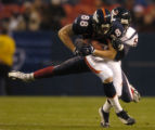 (Denver, Colo., August 27, 2004)  Broncos' Jeb Putzier is tackled by Texans' Jay Foreman in the...
