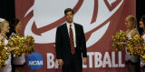 New University of Denver basketball head coach, Joe Scott walks into the press conference,...