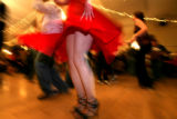 DLM1901  Skirts fly as dancers warm up before the start the Colorado Salsa Open State...