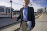 Jon Esty, a transit proponent and president of the Colorado Rail Passenger Association stands at...