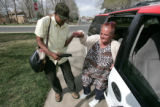 "Daniel Negash (cq) a Denver area taxi driver, helps ""Miss Melanie"" out of his cab March..."