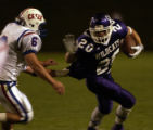 (AURORA, Colo., SEPTEMBER 3, 2004) Arvada West High School's #20 trys to elude Cherry Creek's #6...