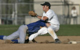Base runner for Wheatridge Kenny Swanson, left, was called safe after plowing into Columbine...