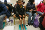 Eric Martinez, (cq), 8, was a rookie at foot washing but gave it a try. (center of frame with his...