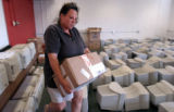 (AURORA, Colo., Sept 2, 2004) Michelle Aree Smith volunteers unpacking school supplies at the New...