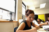 (DENVER, CO., AUGUST 26, 2004) Blanca Silva, 15, does classwork in Mrs. Louise West's Intro to...