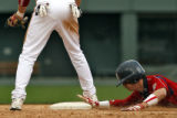 DLM0184  Chaparral's Mike Frank slides safe into the base as he steals second at Coors Field in...