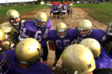 (DENVER, CO., AUGUST 27, 2004) The North High School Vikings huddle during an after school...