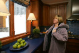 Lorie O'Neill, from Tennessee, looks out the window from the kitchen of her new HGTV Dream Home in...