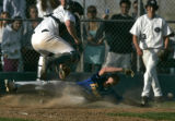 Columbine catcher C.J. Gillman, top, leaps to avoid Weatridge's Adam Doyle as he slides safely...